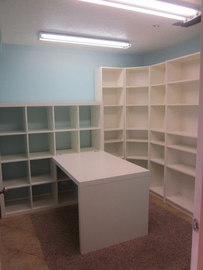 stages of new craftroom...love the ikea shelves