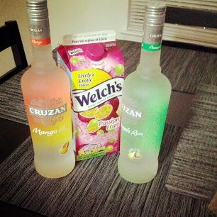Cruzan Confusion ~ 4 cups of Pineapple Cruzan Rum, 4 cups of Mango Cruzan Rum, ½ Gallon Passion Fruit Juice, 1 Orange