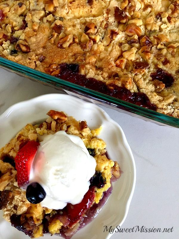 This Cherry Berry Dump Cake is our take on the infamous Cherry Dump Cake, but with added layers of juicy blueberries and strawberries. So, it is not as sweet as the original recipe, but still has the same gooey, fruit bottom, with a buttery, crumbly, nutty, crispy topping!