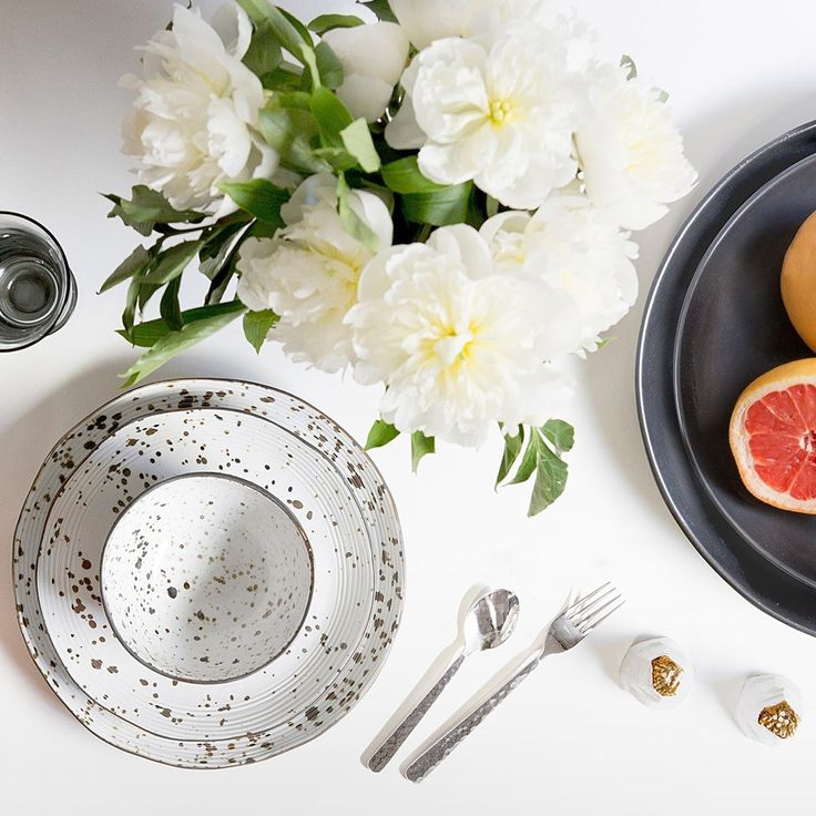 Our Stella collection is a speckled-glazed showstopper. Pair the porcelain plates, which are fired at a much higher temperature than earthenware to achieve the material's impenetrable texture, with simple white serveware for a standout setting, or mix and match with other colors and patterns for a truly eclectic tablescape. An undulating rim highlights the handmade quality of each piece; a multi-lined ridge adds a structural contrast to the one-of-a-kind finish.  Finish: Speckled White ...