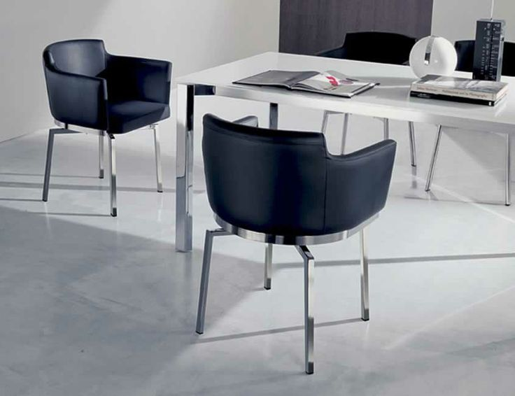SWING, design: Studio Ozeta Metal frame swivel armchair with soft leather covering.www.ozzio.com