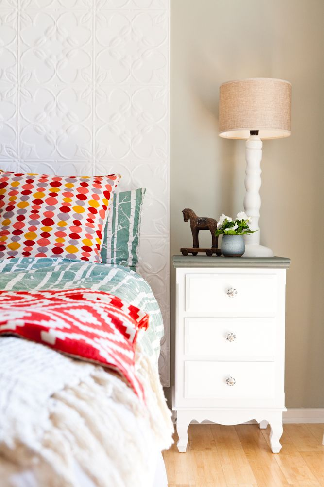 """Maya's bedroom - A quirky retreat with His and Hers bedside tables, pressed tin headboard, linen bed cover from Moochie Lou.  Walls painted with Dulux """"Still"""" in half-strength."""