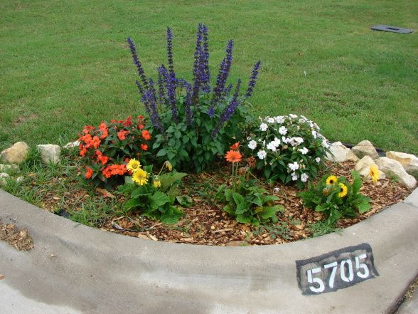 Front yard corner landscaping ideas hgtv hgtvremodels for Small flower bed ideas