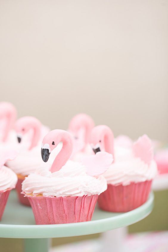 "Flamingos are all the rage. Is it because they're pink? Tropical? Who knows but we're officially declaring them the ""it bird"" of 2015. These cupcakes may be too pretty to eat!"