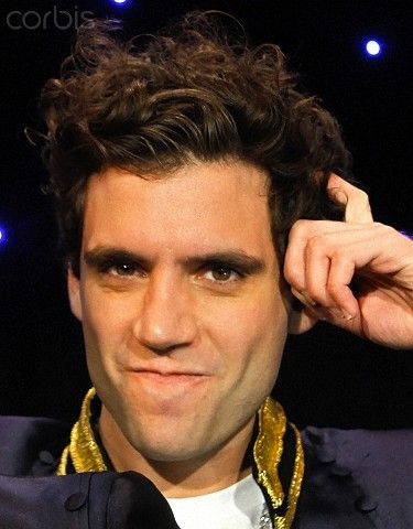 British singer Mika reacts to Wika, his wax likeness during a visit to the…