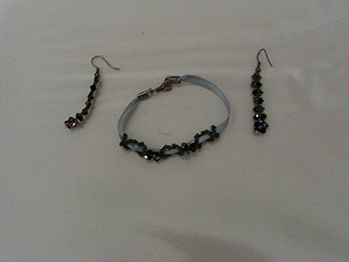 Parure bracciale ed orecchini nera gioielli http://www.amazon.it/dp/B00M1UOXXM/ref=cm_sw_r_pi_dp_r8i4tb0ZY1GWQAY4