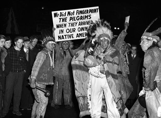 """stackaly: """"In this Dec. 26, 1940 picture, Iroquois Indians who were born in Canada march through the main street of Buffalo, N.Y., carrying signs protesting that the U.S. pilgrim fathers were not..."""