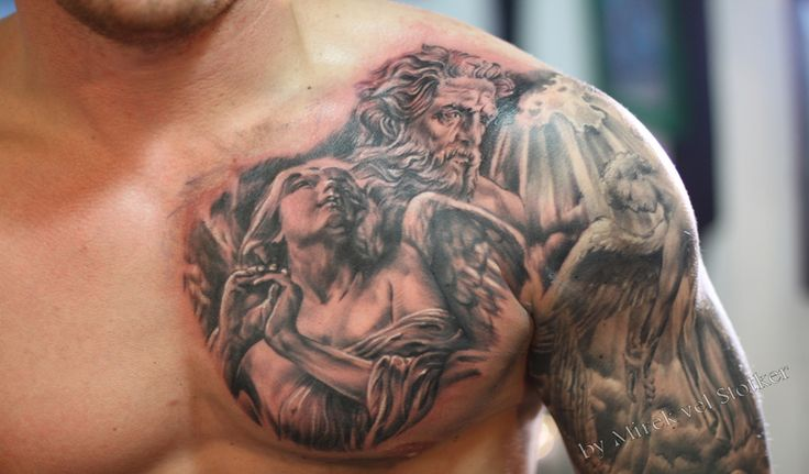 An extraordinary looking chest/shoulder/arm tattoo (body art) imaging some saint, religious beings like angels.