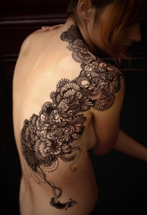 Lace shoulder and back tattoo. tattoo tattooed ink inked black lace design