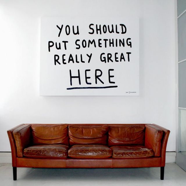 I'm a sucker for a unique leather couch like this. The artwork is fun, too. (Fancy - Something Great by Ian Stevenson)