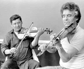 """Lawrence Flett and Laurence Houle.  Central to Métis musical culture, both past and present, is a fiddle and dance tradition which reflects Scottish, French and Aboriginal roots as well as other influences.  Fiddling has been so identified with Métis culture that Turtle Mountain players say, """"There's no Metchif without no fiddle.  The dancin' and the fiddle and the Metchif, they're all the same."""""""