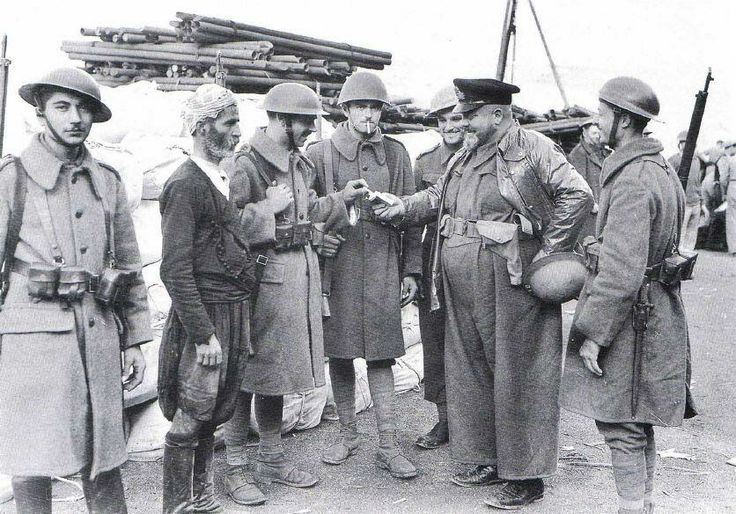 Greek soldiers mingle with a local civilian on Crete prior to the German invasion of the island., c.1941