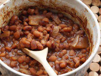 Beans and franks are slowly baked with flavorful seasonings. This recipe makes a tasty budget meal with cornbread and a tossed salad or slaw.