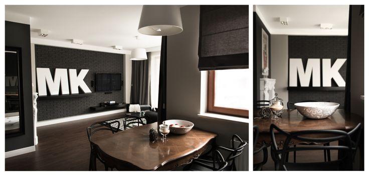 apartament z dużą ilością ciemnych barw we wnętrzu