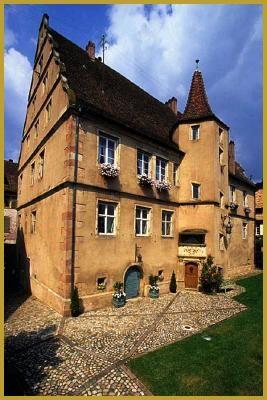 """Andlau Bas-Rhin Alsace France - Ancien Hôtel particulier des Sires d'Andlau du XVIe siècle. Bâtit en 1582 par l'une des quatre fils de Frédéric d'Andlau, """"La Seigneurie"""" possède toutes les caractéristiques d'une demeure bourgeoise de la Renaissance, construire en maçonnerie de grès, elle est coiffée d'une haute tour à deux pans et ornée de pignons à volutes, très à la mode a la fin du XVIe siècle."""