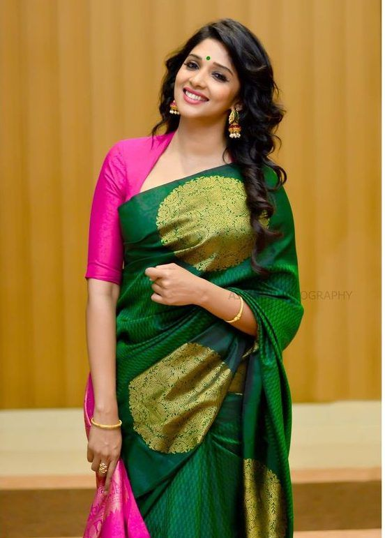 Hot pink scooped neck with three quarter sleeve blouse and green silk saree