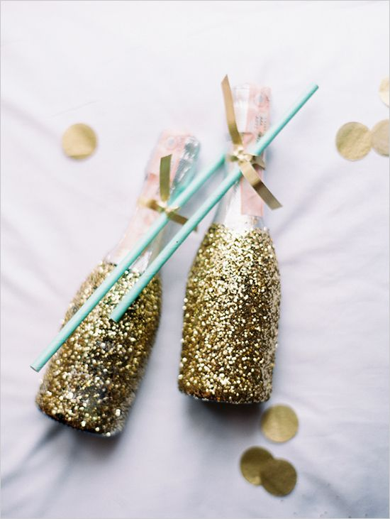 Mini glittered champagne bottles would make fantastic wedding guest favours at a gold themed wedding. Photo via Wedding Chicks.