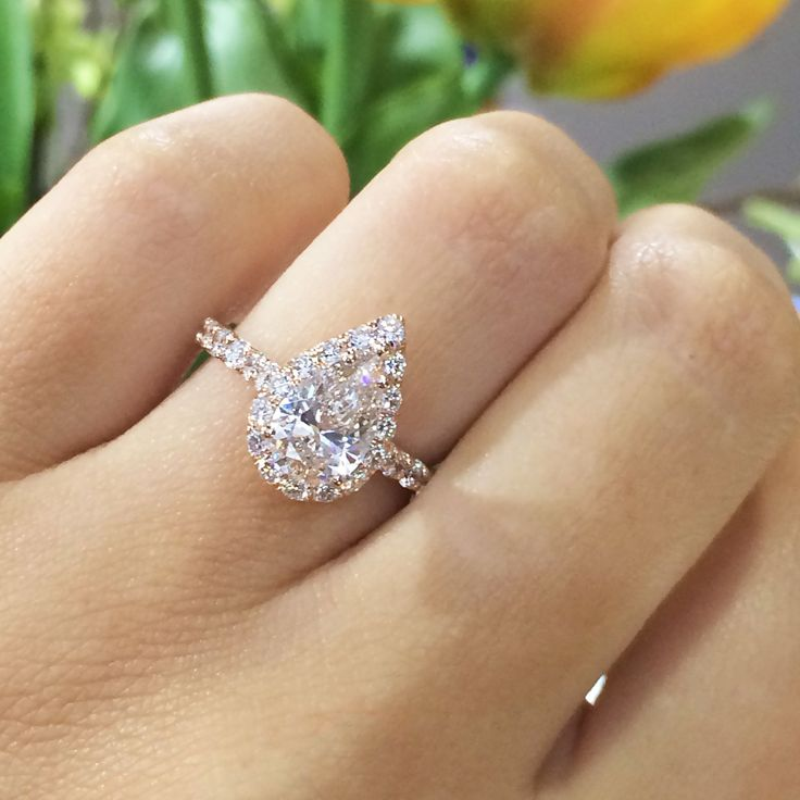 14k Rose Gold diamond engagement ring, containing round diamonds 3/4 down band, holding 1.20ct Pear Shape diamond #WeddingJewelry #engagementrings #weddingring