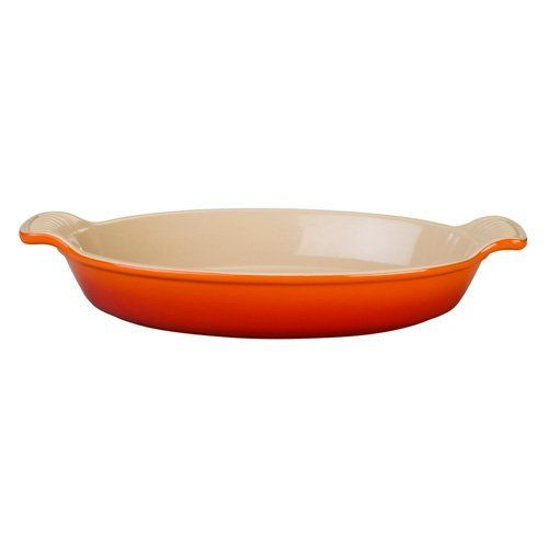 Le Creuset Heritage Oval Au Gratin Dish, 21 oz.: Flame . Save 17 Off!. $24.95. The rich culinary legacy of Le Creuset is reinvented with the Heritage collection. This Le Creuset 21-oz. au gratin dish is a revived version of the original handcrafted design, updated with a refined look for the modern kitchen. With the shallow oval depth, cheese topping bakes evenly and bread crumbs brown to a light, golden-crisp texture. Preferred by chefs for the overall strength and durability, Le Creuset...