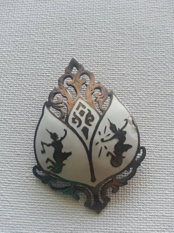 Check out this item in my Etsy shop https://www.etsy.com/listing/523483065/vintage-siam-enamel-sterling-silver
