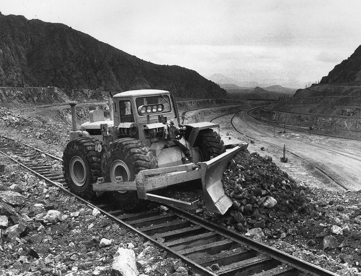 Taken in Nevada in 1965, this C Tournatractor is working in a large copper mine keeping the tracks clear where the railroad cars are loaded by shovels. This is a task a tracked machine would not be able to perform. Machine has the factory supplied cab and the 13' Angledozer.