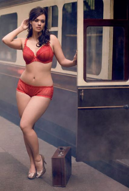 No idea why she is in her undies at a train station,
