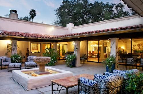 cliff may hacienda style homes. Gorgeous open courtyard. Large white French doors with paneled windows. Outdoor seating. Fountain or water feature in center. Large oversized planters with vines growing on columns