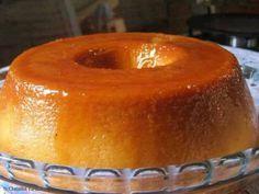 Pudim de pão de liquidificador. Ingredientes  4 ovos 1 lata de leite condensado 3 pães (francês) 1 colher de margarina 2 medidas de leite (medir na lata de leite condensado) 1/2 xícara de açúcar 1 xícara de açúcar para a calda