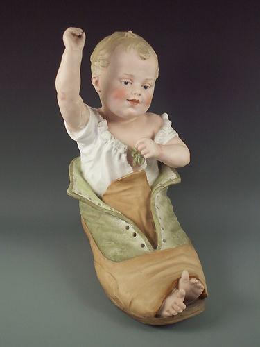 Antique Heubach Piano Baby in Shoe Figurine