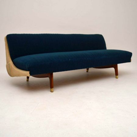 A very stylish and comfortable vintage sofa bed, this was made in Denmark, it dates from around the 1950-60's. It is in very good condition for its age, with some minor wear here and there.The blue fabric is free from any marks, it has worn a little thin on some edges. The off white fabric has a little wear and some minor marks here and there, seen in the images. this has a click clack mechanism, the back folds down flat to make an ample sized guest bed.