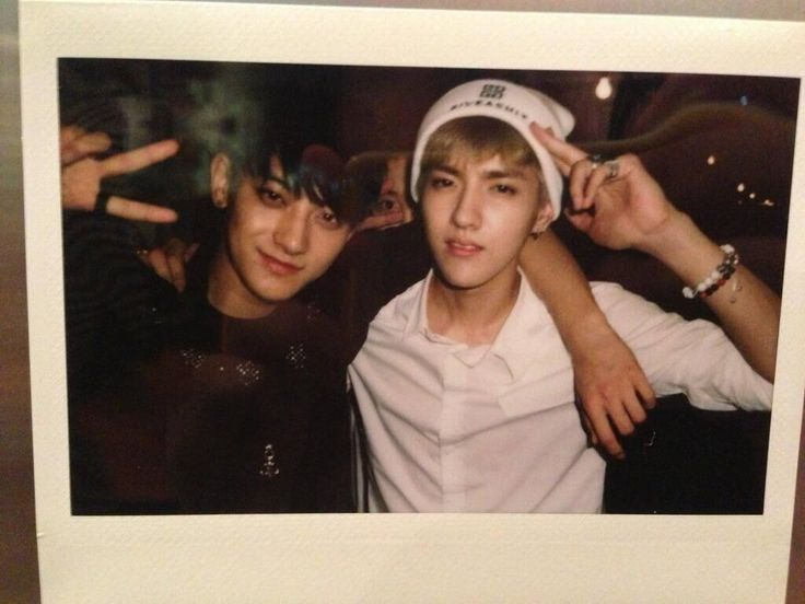 EXO Tao & Kris ... and D.O. creepin' in the back.