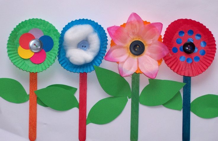 Free craft idea for children row of flowers using muffin pans, pop sticks, buttons and more