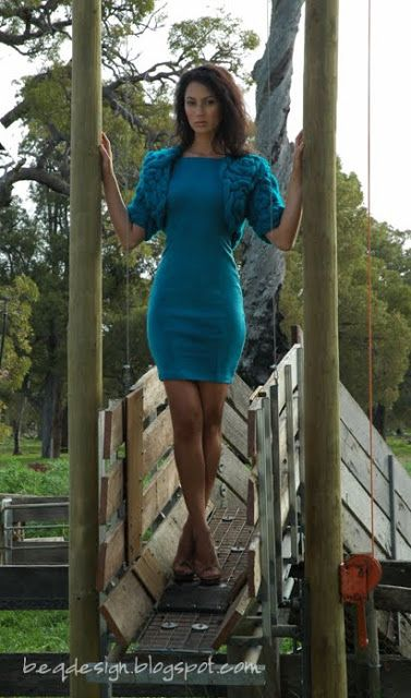 Knitwear Designer: Rebecca Timson, Model: Mikka Hendrawidjaja. Designed and created for Perth Fashion Festival - A Touch of Wool III. Dress fabric WA Superfine  Wool.  A Beq Design creation Teal Woollen Dress with knitted top, womans knitwear