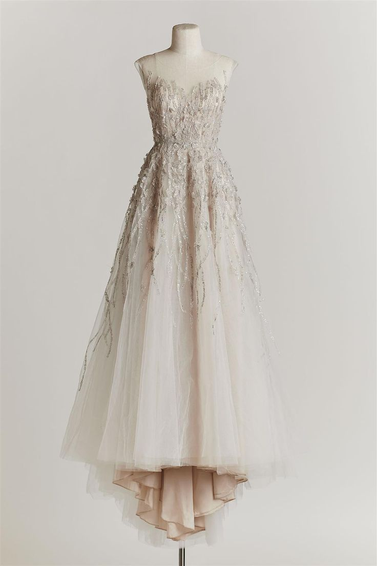 Love the hint of blush in the layers of this dress!