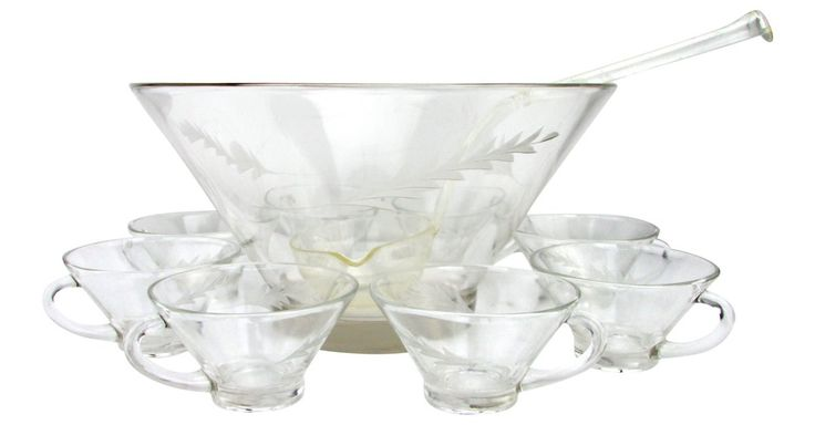 "Midcentury punch bowl with cut-glass leaf decoration and eight matching cups. Bamboo-style handle plastic ladle. No makers marks. Cups, 4.5""W x 2.15""H; ladle, 12.25""L x 3.75""W x 2.5""H."
