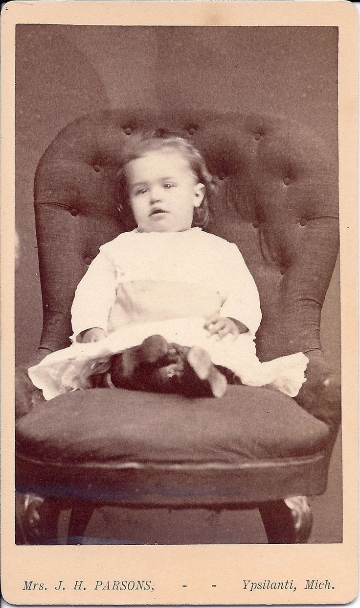 child posed sitting with legs crossed to keep them from ...