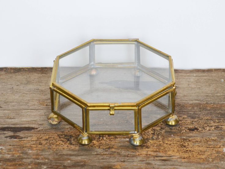 Vintage Brass Curio Trinket Box or display case, lid with latch, glass octagon sides and footed ball feet circa 1970s by Trashtiques on Etsy https://www.etsy.com/ca/listing/569714207/vintage-brass-curio-trinket-box-or