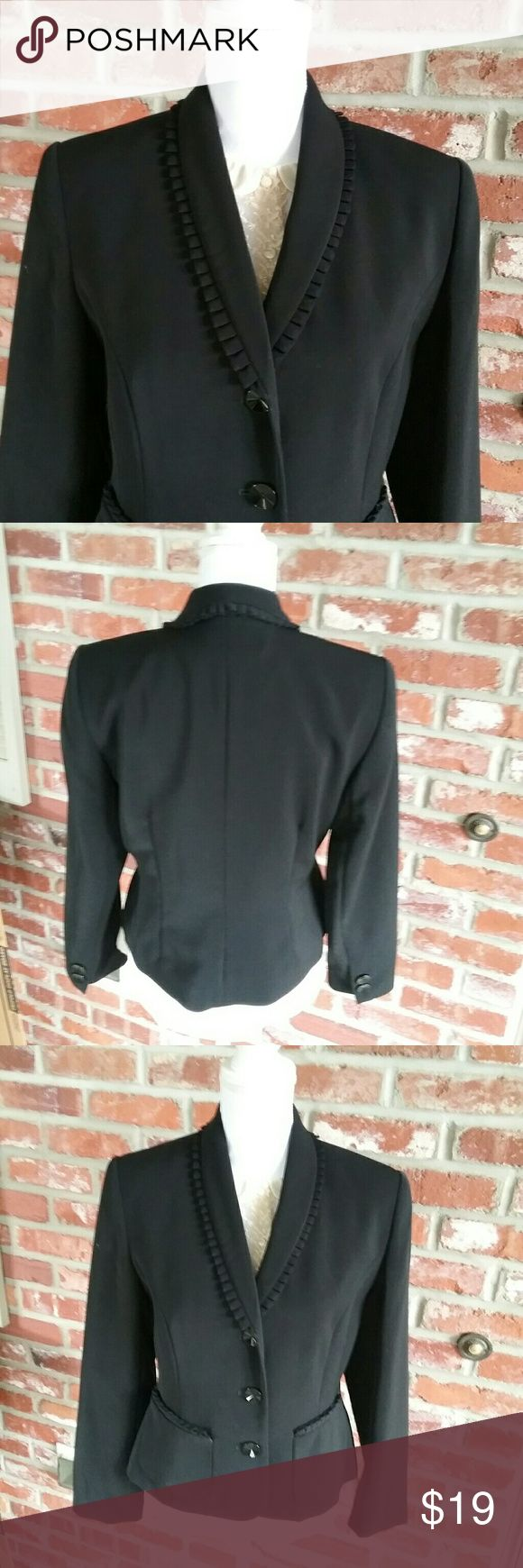 "SAG Harbor Black 10P Suit Blazer Jacket Pleated This is a black Sag Harbor size 10 petite suit Blazer jacket coat. It has pleats around the neckline in the collar. It is lined. Measurements : 19"" Armpit to Armpit  22"" Neck to hem 22.5"" Sleeve  It is in good preowned condition with no stains or flaws noted. Sag Harbor Jackets & Coats Blazers"