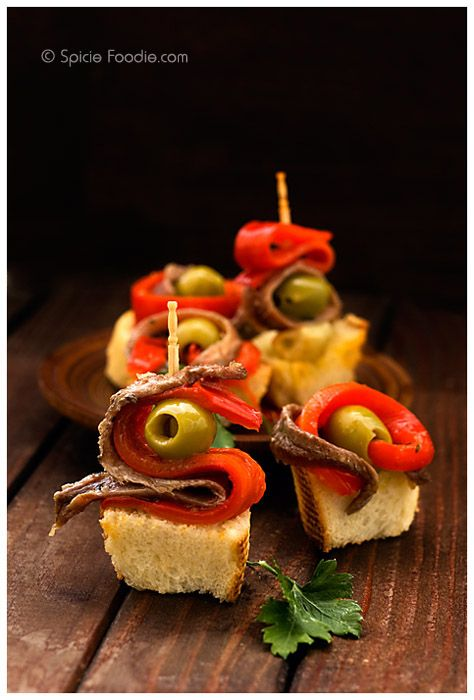Gildas or Anchovy, Olive and Peppers  Anchovies, I used a small can in olive oil  pitted green olives  roasted sweet red peppers, sliced  toothpicks  sliced baguette or crusty bread, optional  olive oil, optional