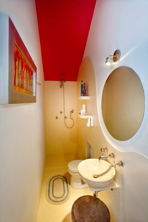 Ceilings can make or brake a room. Here some positive examples to design your own rooms, like this red bathroom ceiling by Taller Estilo Arquitectura.