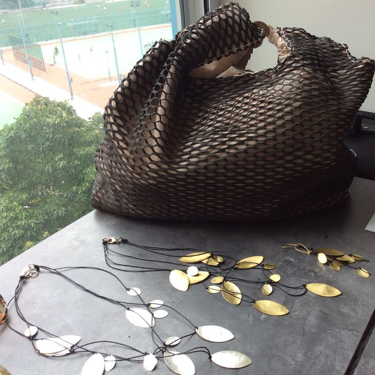 Eleanna Katsira leather net bag travels to Hong Kong