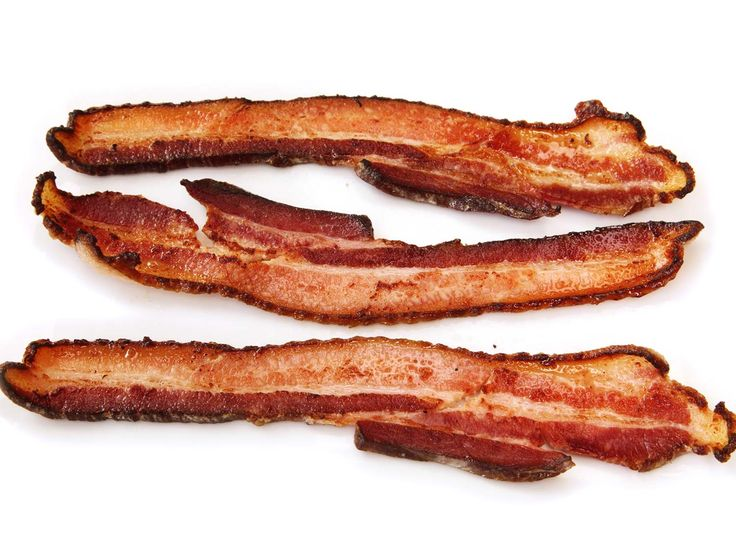 I was skeptical of the idea of sous vide bacon. I generally prefer my bacon cooked completely crisp, rather than trying to get bacon that's crisp and moist at the same time. But bacon cooked sous vide overnight is the first I've ever tasted that delivers on that moist-and-crisp promise. It's crispy on the exterior as you bite into it, but it quite literally melts in your mouth, like the finest confit pork belly, as you chew. Here's how to make it.