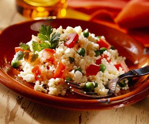 Quick-cooking couscous helps put this dish, reminiscent of Spanish rice, on the table in no time.