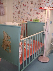 I slept in a crib a lot like this one, only it was not a color, but it had a big decal on the end......