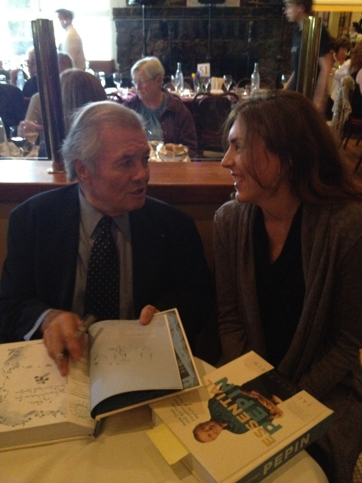 "Jacques Pepin signing his cookbook, ""Essential Pepin,"" for an excited guest!"