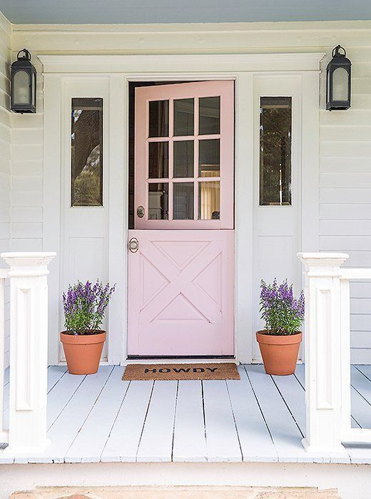 Love the fresh feel of this pastel pink Dutch front door and painted white wide plank porch with potted lavender.