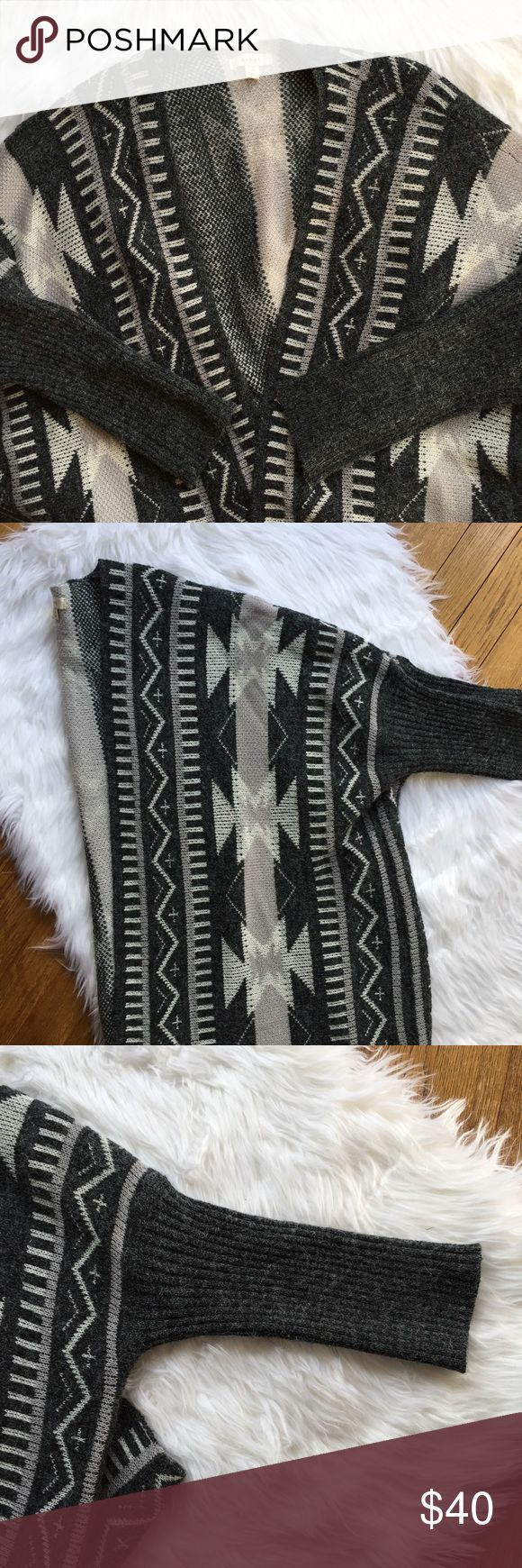 NWOT debut soft cardigan Extremely soft and fuzzy Aztec print cardigan. Open front with ribbed sleeves. Brand is debut. Size M/L. Different shades of gray with some ivory and light  tan colors mixed in/ debut Sweaters Cardigans