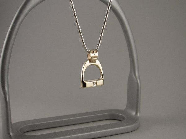 Lovely little diamond stirrup pendant which combines half sterling silver with half 9ct yellow gold with a cute buckle top to complete your look this season.