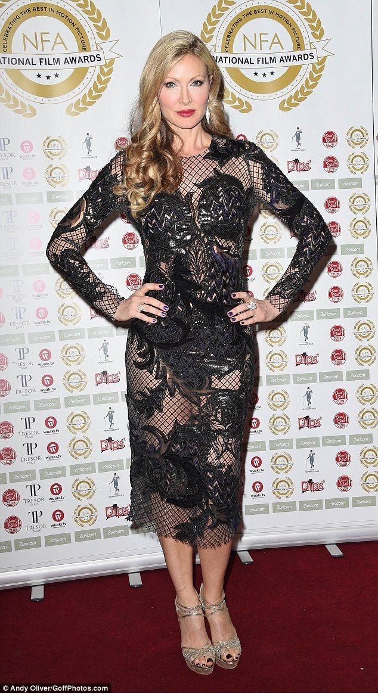 Tulisa flaunts unicorn tattoo in pink dress at National Film Awards #dailymail