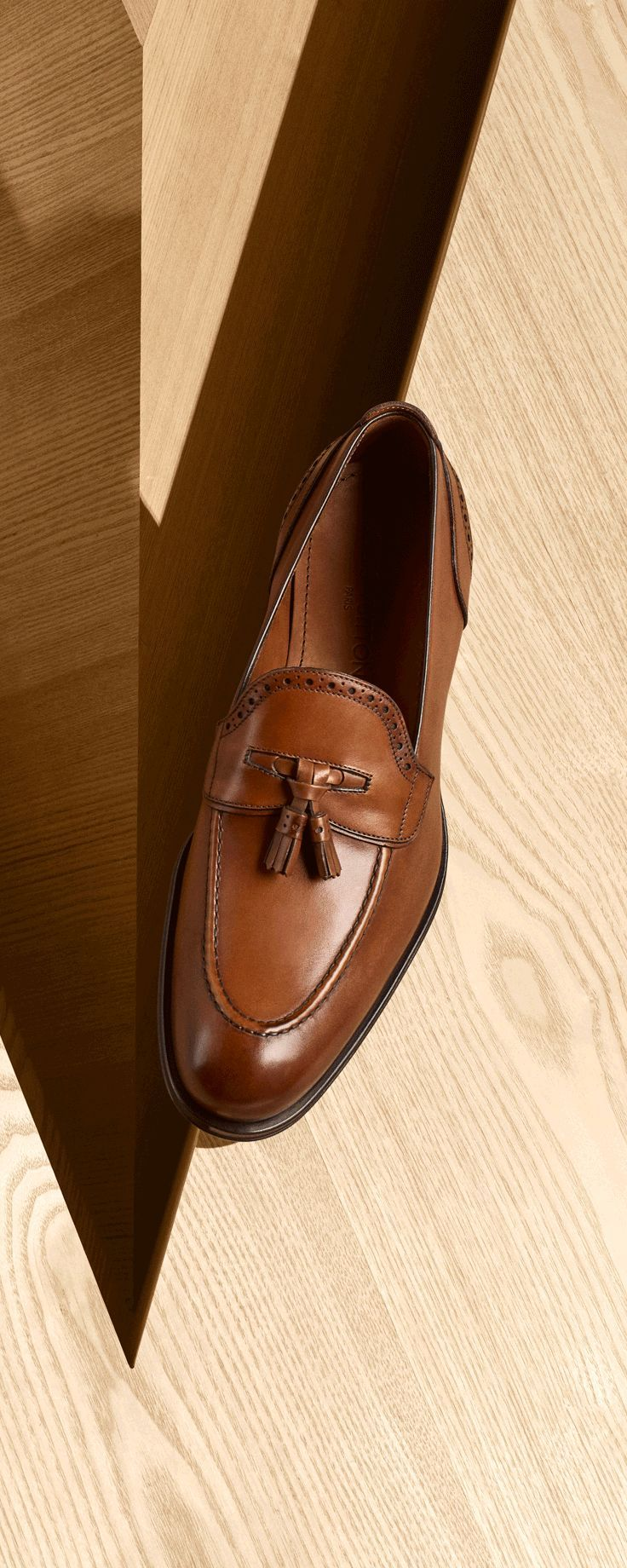 A true wardrobe essential, the elegant Trading Loafer in waxed calf leather in patina finish is decorated with perforations and tassels for a subtle retro touch. Click through to see more Men's Shoes - best mens shoes, brown dress shoes mens, best mens dress shoes